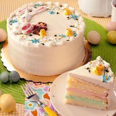 Easter Cake - What a lovely dessert to set on your Easter table.  Moist white cake with layers of our pretty pink, yellow and green butter cream and hand decorated in a fun Easter theme for all to enjoy.  Serves up to 15.  Shipped Monday, Tuesday and Wednesdays.