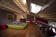 Hyperloft in Trastevere. Funky green bed. €270/night