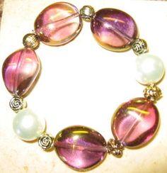Items similar to Amethyst Glow Stretch Bracelet on Etsy Stretch Bracelets, Stretches, Amethyst, Glow, Purple, Pretty, Jewelry, Fashion, Jewellery Making
