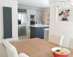 tall vertical grey radiator in kitchen