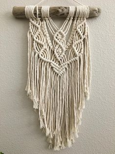 This macrame wall hanging is handmade using 100% cotton rope and is attached to driftwood foraged from the Pacific Northwest coast. It is ready to hang and will look beautiful in any space! The textures and layers provide the right amount of detail and will warm up any room. Makes a