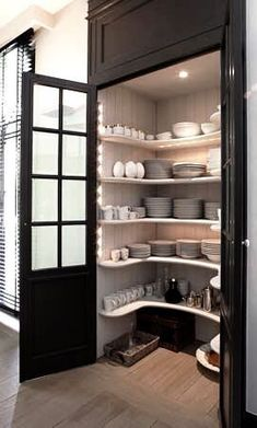 Narrow dish closet on opposite of walk in pantry beside sink & dishwasher