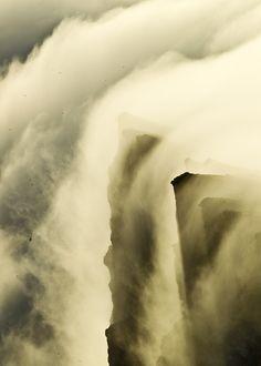 Fog rolling over Látrabjarg, Westfjords by Daníel Bergmann