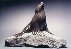 I really like this sea lion stone carving because this piece shows the contrast between the seal and the rock it is sitting on. it might be two separate stones, but it really shows a contrast in colors.  William Nutt Sea Lion Champlain Black (Marble/Limestone)