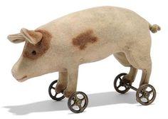 A STEIFF FELT PIG ON WHEELS, circa 1908