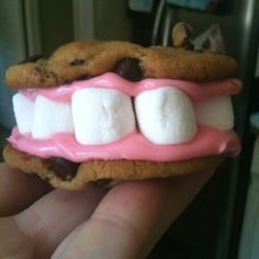 Celebrate when your children have a good appointment with us or when they lose their teeth with this treat! Chocolate chip cookie mouth with pink frosting gums and marshmallow teeth!