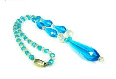 1920s Czech necklace in the colors of aqua and clear. The necklace measures 16 from end to end and has a 1.75 drop.  There are several small chips