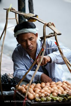 Seller of eggs, Bangkok, Thailand by superUbO.