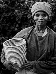 Portrait of a traditional Xhosa woman selling her handmade baskets on the side of the road along the Wild Coast of South Africa.