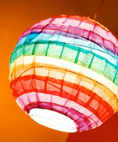 Colorful tissue paper squares were used to cover the outside of this paper lantern.
