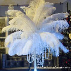 Want to save a lot of money on your wedding or event centerpieces? Learn how to make a feather centerpiece with these step by step instructions.