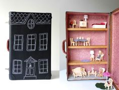 """This portable dollhouse has a chalkboard paint exterior and wooden shelving within to form different """"rooms"""" that can be filled with your kid's favorite dollhouse furniture."""