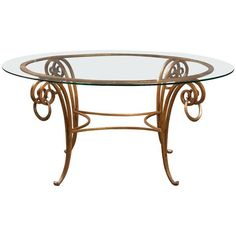 A French round, gilt iron, glass-top coffee table in the manner of Rene Drouet.  Circa 1930's.  16 H x 34 Diam.