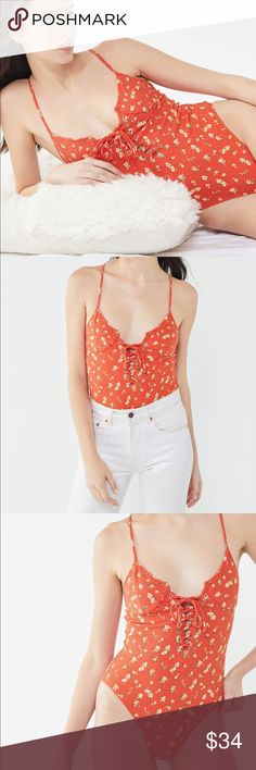 177a00580a3b Red/Orange Out From Under Lorena Lace-Up Bodysuit Ribbed knit bodysuit by  Out