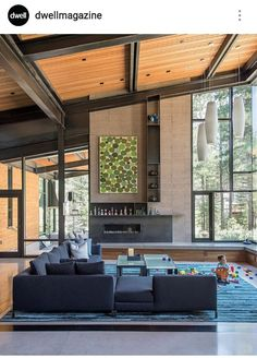 Photo 45 of 50 in 50 Modern Homes With Floor-to-Ceiling Windows from A Forest Sanctuary Designed to Support Autistic Triplets, Their Parents, and a Host of Caregivers - Dwell