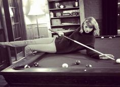 Taylor Swift playing pool.  Hey Taylor you have to have one foot on the floor