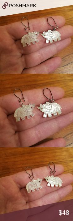 """Vintage Carved Mother of Pearl Elephant Earrings Beautiful mother of pearl elephant earrings with sterling silver hooks (just need to be cleaned) 1.25"""" long Vintage Jewelry Earrings"""