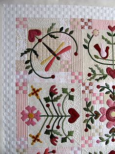 The pattern is Joy of Life by Australian designer Rosalie Quinlan.  Lovely quilting!