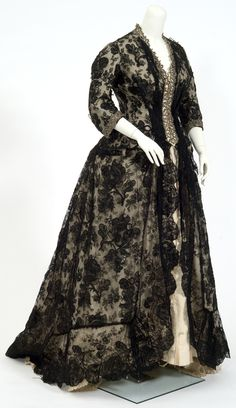 c. 1870's One-piece dress of ivory moiré with one-piece bodice and overskirt of black lace (Chantilly-like). mnhs.org