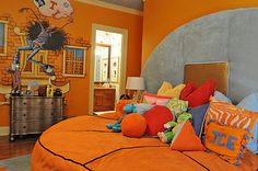 Both of the children's rooms have basketball themes. Daughter Kaela's room features a lively color scheme and a basketball-shaped ...