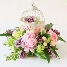 Charming and vintage inspired. This rustic metal bird cage is nestled into a beautiful spring arrangement full of fragrance. Metal Birds, Centrepieces, Bird Cage, Vintage Inspired, Fragrance, Bloom, Victoria, Range, Rustic