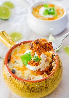 This Chicken Enchilada Quinoa bake is gluten free, packed with protein and loads of cheese. This casserole is a true crowd-pleaser.