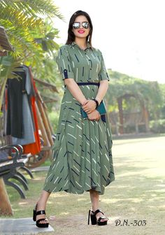 Formal looking designer readymade kurti is olive green color fabricated on rayon. Its rich color and decent pattern will earn you lots of compliments from onlookers. Olive green long kurti online shopping for Women. Party Wear Kurtis, Kurti Designs Party Wear, Kurta Designs, Party Wear Sarees, Blouse Designs, Kaftan Style, Lehenga Style, Fancy Kurti, Frock Fashion