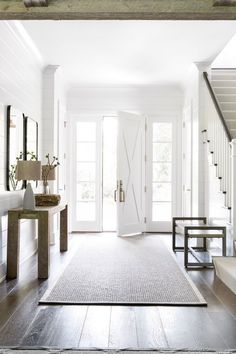 If you're a fan of modern farmhouse interior design, then bookmark this post as I show you how to combine traditional home décor with modern industrial accessories and lighting. Modern Farmhouse is a rustic yet refined style of interior, and with a Modern Farmhouse Interiors, Farmhouse Decor, Farmhouse Style, Country Decor, Coastal Farmhouse, Farmhouse Ideas, Country Hallway, Farmhouse Bench, White Interiors