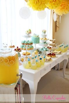 Wedding shower food table. This is adorable! Bright & cheery yellow & white with gorgeous pops of blue!