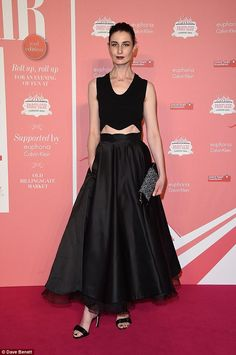 All black: Erin O'Connor looked every inch the statuesque beauty in a chic black two-piece...