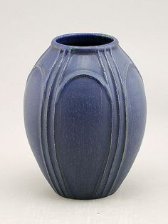 "Designed with the bridges of Venice in mind, the Venice vase showcases strong architectural elements and a simple balance of proportion and shape. This contemporary vase is glazed in our deep, rich Arts and Crafts Blue, just like the waters under the bridges of Venice! - 8""h x 6.25""w  Thrown by John Tiller  Designed and decorated by Nicky Ross  Glazed by Scott Draves"