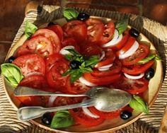 A simple tomato salad recipe, with onion garlic, basil and olives