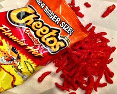 Flamin' Hot Cheetos are a type of Cheetos puff snack that are spicier than normal Cheetos. They are frequently referenced in memes for their spicy taste and their creation story has inspired an in-production biopic for their creator. I Love Food, Good Food, Yummy Food, Doritos, Spicy Cheetos, Dip, Healthy Holistic Living, Junk Food Snacks, Food Cravings
