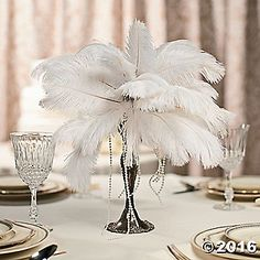 Create a stunning DIY centerpiece that will be the highlight of your wedding décor! Accented with pearl beads and feathers, all eyes will be on this ...