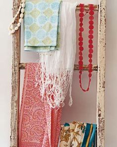 Ladder as Accessory Display - Why keep pretty printed scarves and beloved beads tucked away? Dispatch a ladder to artfully display some of your favorite things―and to introduce color and patterns into a room.