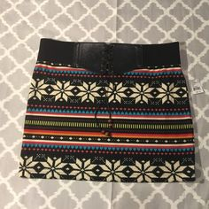 NWT Fair isle belted skirt BRAND NEW WITH TAGS! Super soft mini skirt in a vibrant fair isle print. Elastic waist with patent leather lace up front that creates a faux belt Luna Chix Skirts Mini