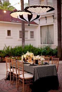 Love the elegance of the chivari chairs with the quirkier use of umbrellas and polka dots