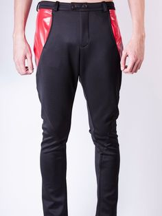 https://www.cityblis.com/6462/item/16937  Men's black pants with shifted side seams and red pleather details - $329 by The InSane Studio  Label: Bedlamite men's wear Collection: AW13 Murder on the Dance Floor SKU: 13MDFPT021 Delivery Time: 5 Weeks upon confirmation of payment  Made to Measure only Please contact us for the size to be made. We will only start production when the payment is confirm. All products are Made in Sing...
