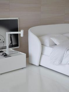 A precise market analysis suggested that the collection of convertible armchairs and sofas would benefit from the addition of a double-size bed. The headboard is comfortable and gently rounded at the sides expressing the protective, welcoming nature of Céline by Flou. The completely removable covers are available in fabric, Ecopelle or leather.  #Bedroom #InteriorDesign #HomeDecor #Furnishings #totalwhite