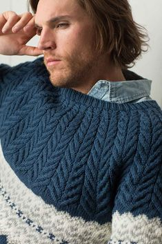 The Bergen Peak Pullover by Irina Anikeeva features updated takes on two classic techniques: Fair Isle and cables. This handsome pullover knitting pattern has flowing staghorn cables at the yoke and a striking graphic stranded colorwork band across chest and upper arms. It is worked in the round from the bottom up.
