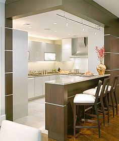 Kitchen  A gourmet kitchen with aluminum cabinetry by Poggenpohl is open to the living areas and view beyond