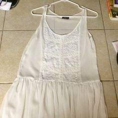 See through flowy tank Designs and sheer. Really cute with a brallete or bandeau. Tops Tank Tops
