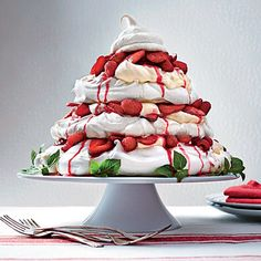Red Berry Pavlova Tower Red Berry Pavlova Tower | A heavenly Christmas dessert. The irresistable Cheesecake Icing sets this over the top.