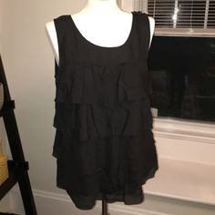 JCrew Ruffled tank size 8 JCrew Ruffled tank size 8. Gently worn, great condition. Zipper side closer, black and 100% silk. J. Crew Tops Blouses
