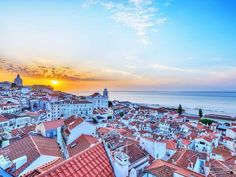 Sunrise over the red roofs of old #Lisbon #Portugal