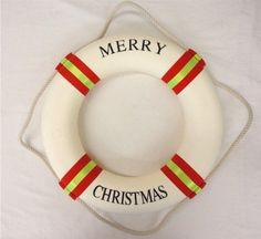 Large Merry Christmas Nautical Cloth Life Ring - Door Wreath  I would do this as a DIY and use either red velvet ribbon or some route of greenery instead of their colors