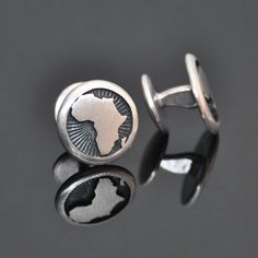 Round Africa Cufflinks.  Bold and stylish, solid sterling silver, African cuff-links bordered with black or turquoise ocean fill.