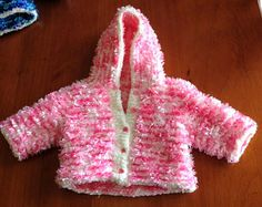 Hand knitted Pink and White Striped Newborn Size Jacket with Hood. Knitted in White Baby Chenille and Pink Flurry Wool. Dog Onesies, Pink And White Stripes, Baby Knits, Fingerless Gloves, Baby Knitting, Yeezy, Arm Warmers, Underarm, Hooded Jacket