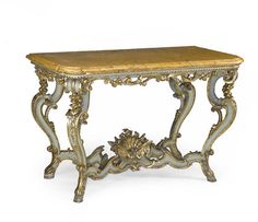 ITALIAN ROCOCO PAINTED AND PARCEL GILT CONSOLE TABLE SECOND QUARTER 18TH CENTURY.