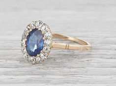 Vintage Victorian ring made in 18k yellow gold and centered with an approximately 1.20 carat natural sapphire. Accented with single cut diamonds weighing approximately .40 carats total. Circa 1890. Featuring a delicate band and a beautiful steely sapphire perfectly accented with a halo of diamonds. An incredibly delicate and modern ring rooted in the elegance of the past. Diamond and gold mining has caused devastation in areas such as Africa, wreaking havoc on delicate ecosystems and…